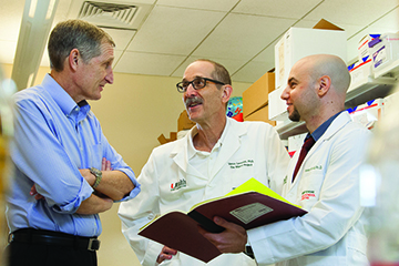 Drs. John Bixby, Vance Lemmon and Hassan Al-Ali